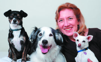 Woman With Three Dogs.